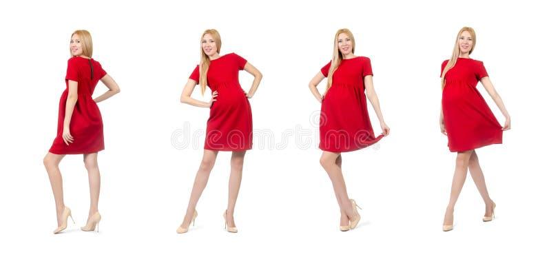 De vrij zwangere vrouw in rode die kleding op wit wordt geïsoleerd royalty-vrije stock afbeelding