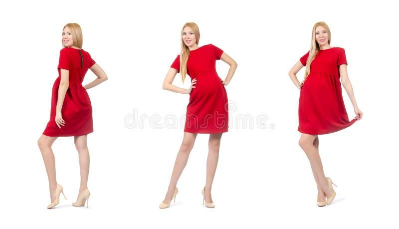 De vrij zwangere vrouw in rode die kleding op wit wordt geïsoleerd stock afbeeldingen