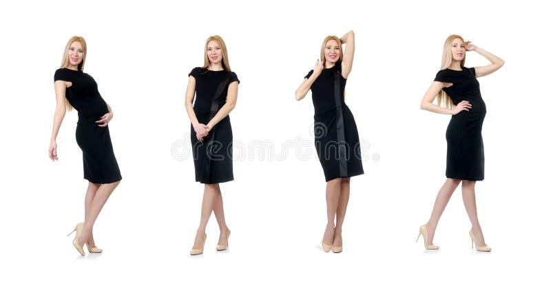 De vrij zwangere vrouw in zwarte die kleding op wit wordt geïsoleerd stock afbeelding