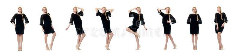 De vrij zwangere vrouw in zwarte die kleding op wit wordt ge?soleerd stock afbeeldingen