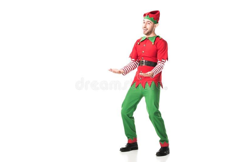 de vrolijke mens in het kostuum van het Kerstmiself het outstreching dient geïsoleerde opwinding in royalty-vrije stock foto's