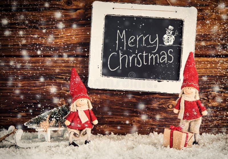 De vrolijke scène van de Kerstmissneeuw met groet royalty-vrije stock afbeeldingen