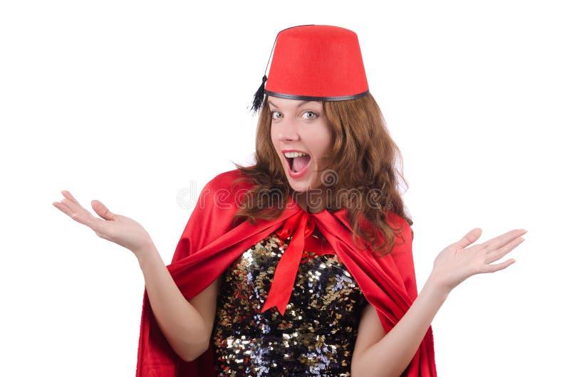 De vrouw die de hoed van Fez dragen die op wit wordt geïsoleerd royalty-vrije stock foto