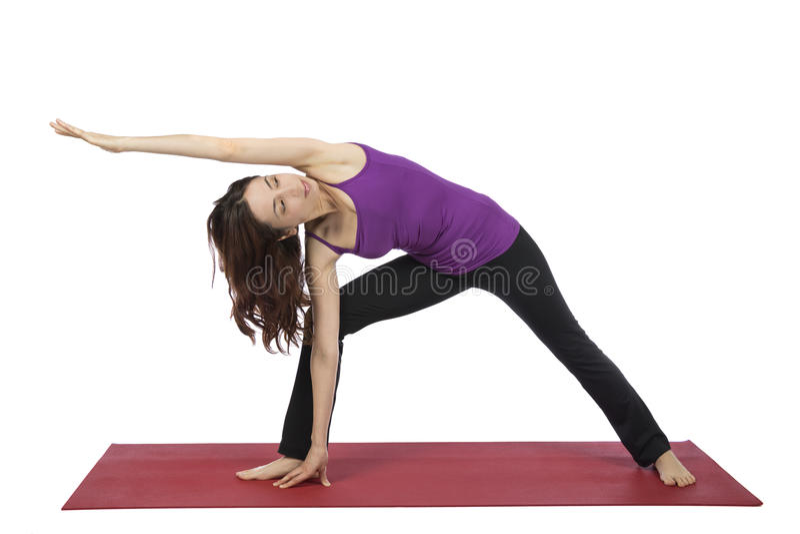 De vrouw die Uitgebreide Zijhoek doen stelt in Yoga royalty-vrije stock afbeelding