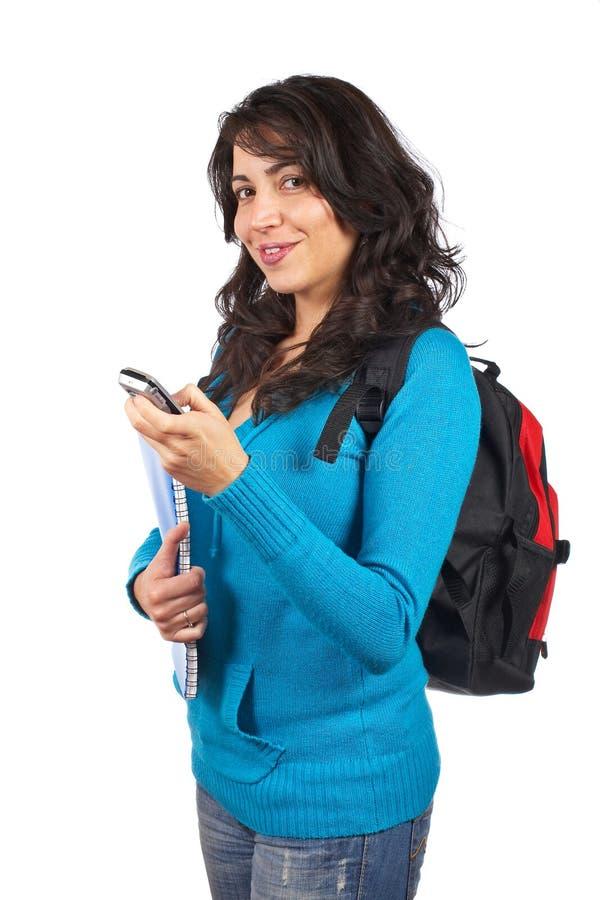 De vrouw die van de student sms verzendt stock foto's