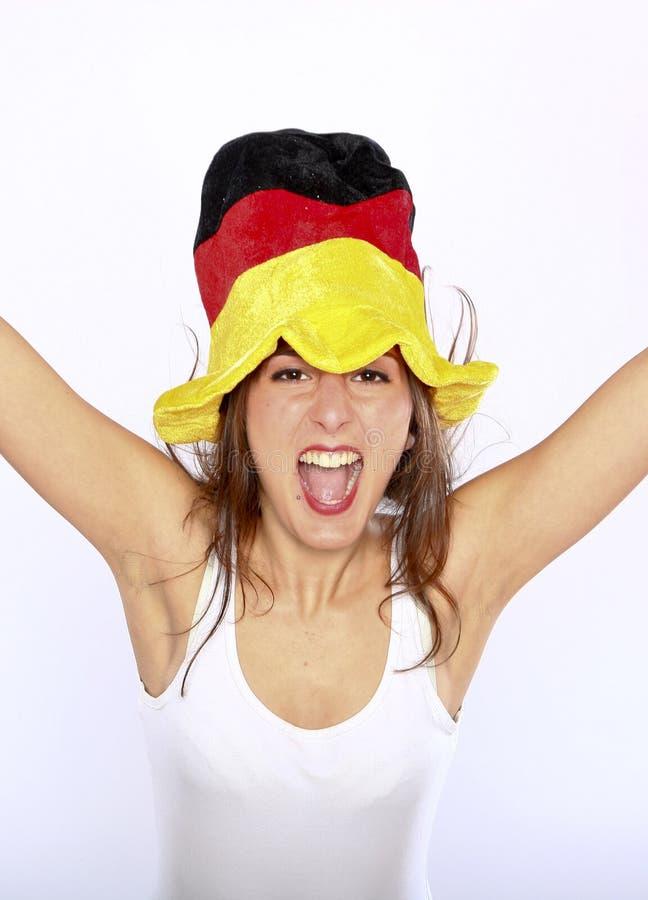 De Vrouw die van de Ventilator van het voetbal een Hoed draagt royalty-vrije stock afbeelding