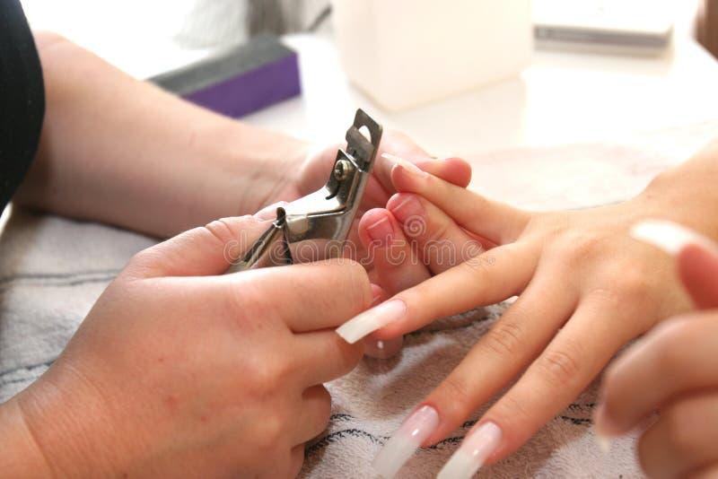 De vrouw doet manicure. stock foto's