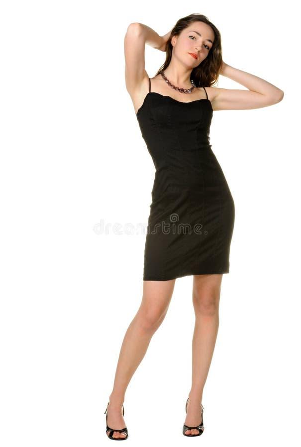 De vrouw in een zwarte kleding. royalty-vrije stock fotografie