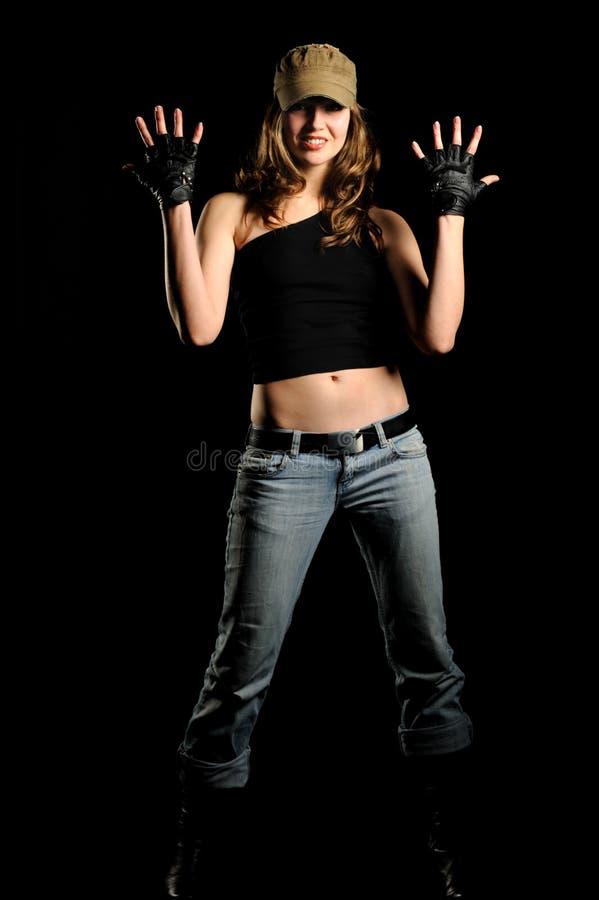 De vrouw in jeans en een modieus GLB stock fotografie