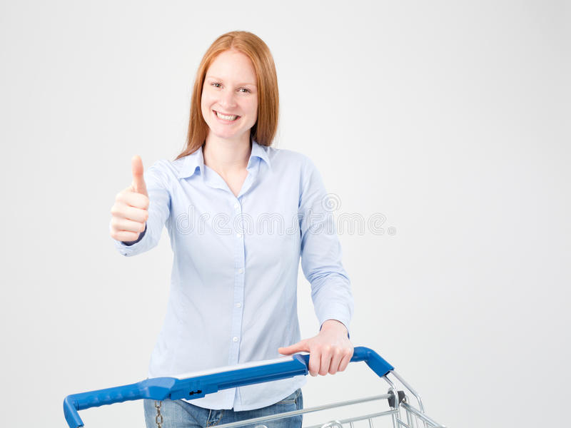 De vrouw met Boodschappenwagentje het Geven beduimelt omhoog stock foto's
