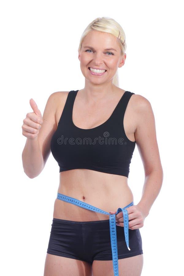 De vrouw met duimen heeft omhoog gewicht verminderd stock foto