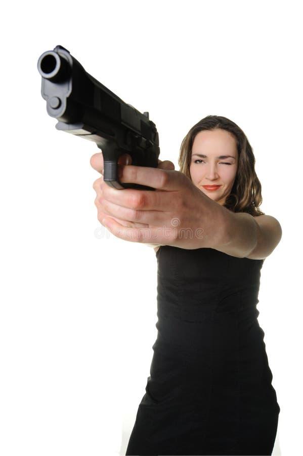 De vrouw met een pistool stock fotografie