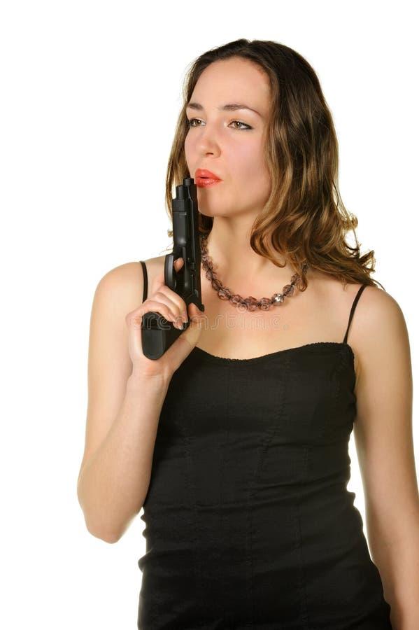 De vrouw met een pistool stock foto's