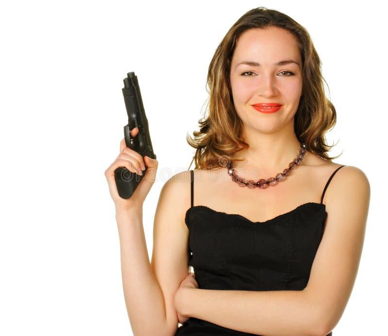 De vrouw met een pistool royalty-vrije stock foto's