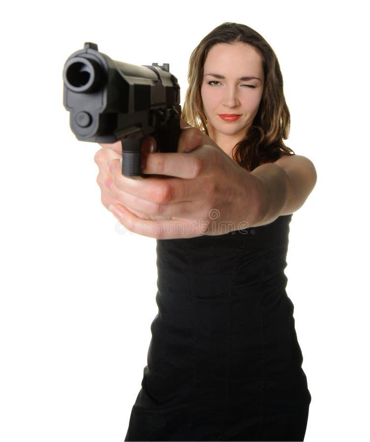 De vrouw met een pistool royalty-vrije stock afbeeldingen