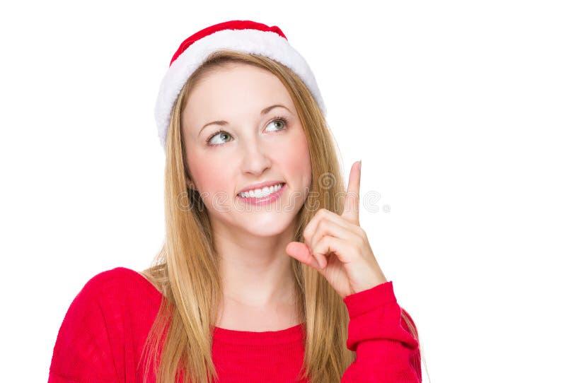 De vrouw met Kerstmishoed en denkt aan idee stock foto
