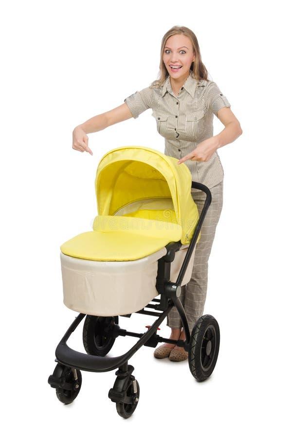 De vrouw met kinderwagen op wit wordt geïsoleerd dat royalty-vrije stock foto