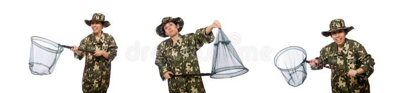 De vrouw in militaire kleding met netto vangen stock afbeelding