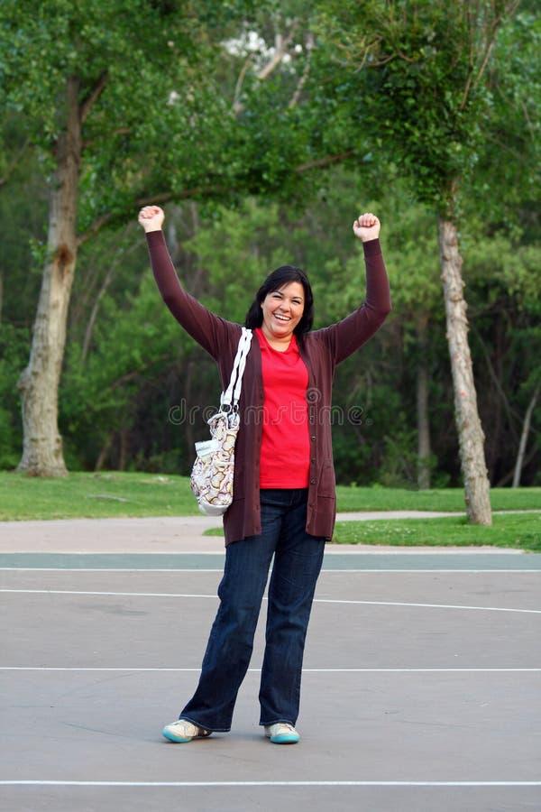 De vrouw schreeuwt Hooray! stock fotografie