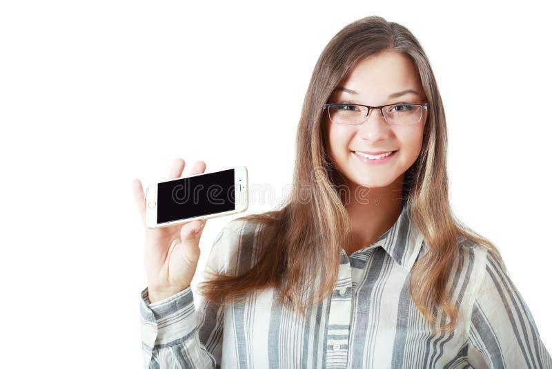 De vrouw toont vertoning van mobiel royalty-vrije stock fotografie