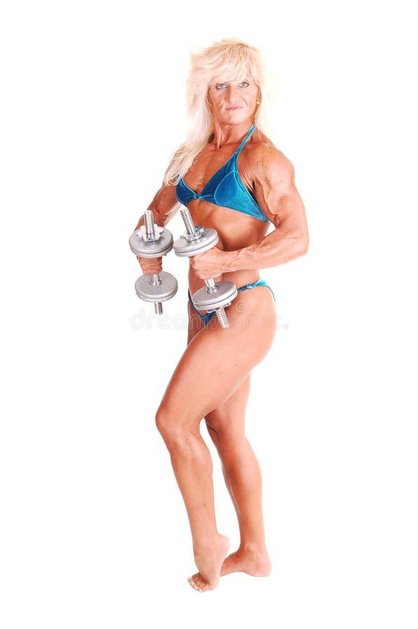 De vrouw van Bodybuilding. stock afbeeldingen