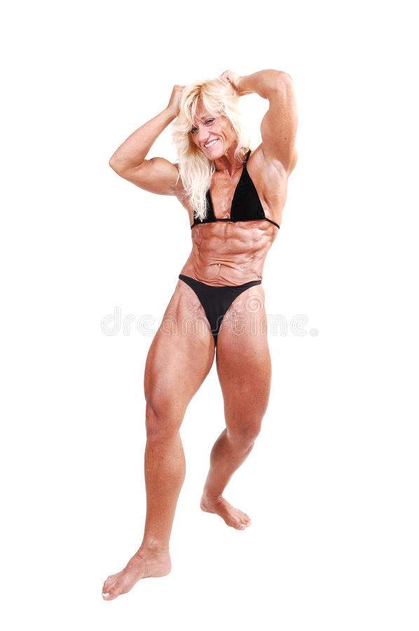 De vrouw van Bodybuilding. stock afbeelding