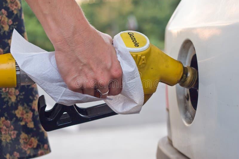 De vrouw van de benzine royalty-vrije stock afbeelding