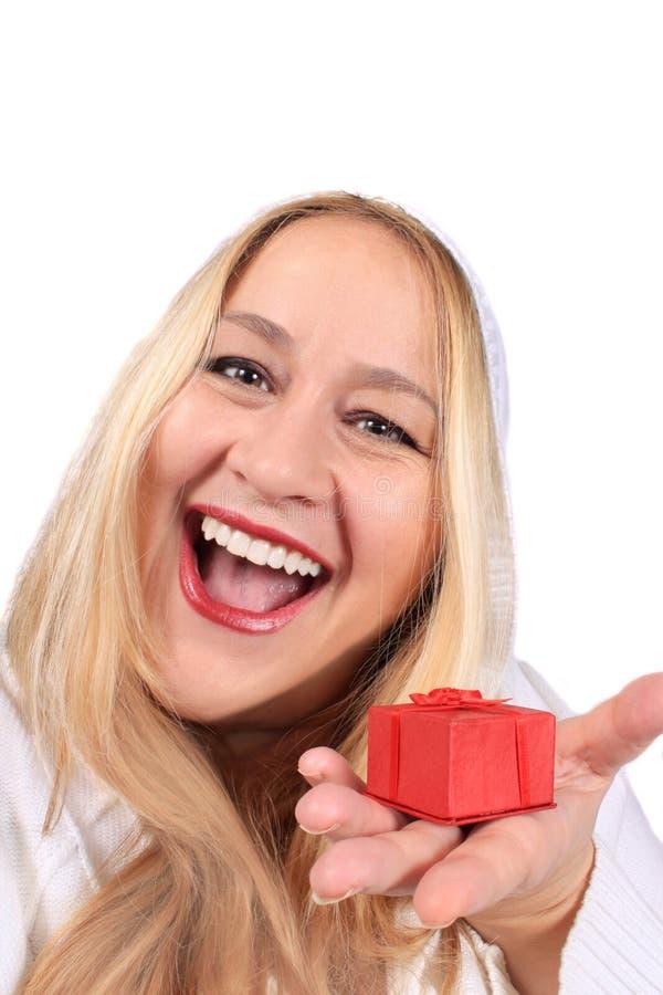 De vrouw van de blonde toont heden stock afbeelding