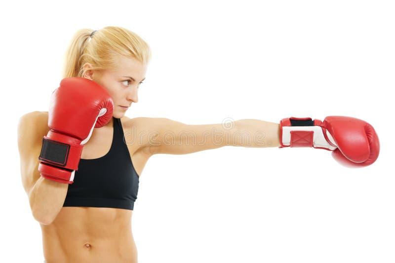 De vrouw van de bokser met rode bokshandschoenen royalty-vrije stock fotografie