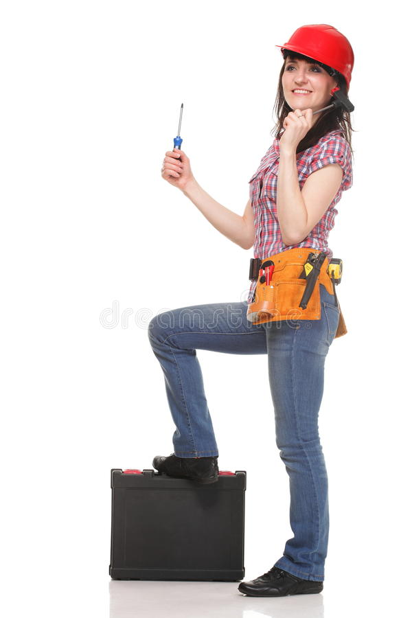 De vrouw van de bouwer met hulpmiddelen stock afbeeldingen