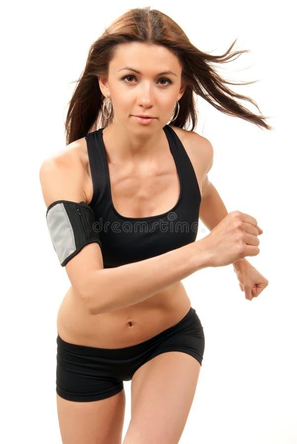 De vrouw van de geschiktheid bij dieet aanstoten, die in gymnastiek loopt stock afbeelding