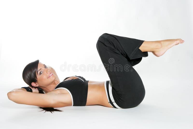 De vrouw van de gymnastiek stock foto's
