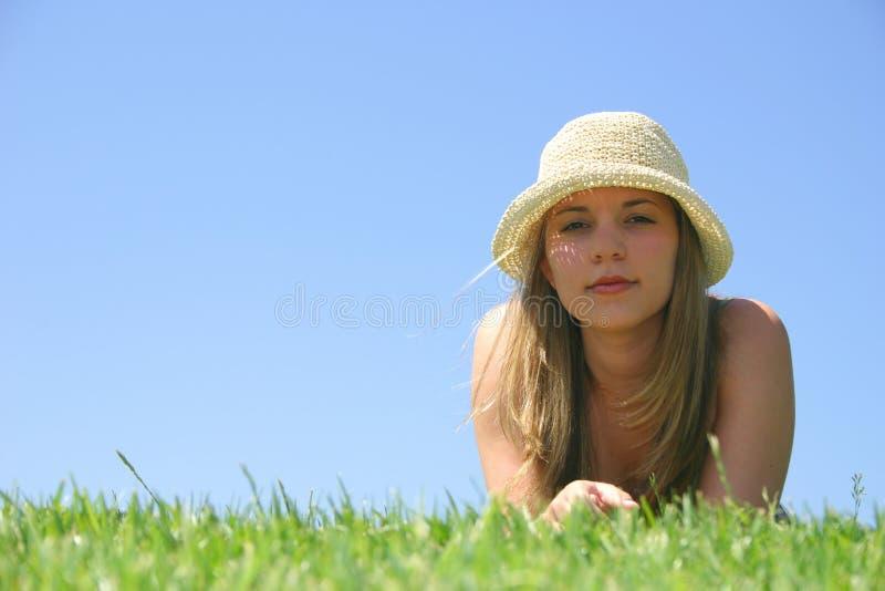 De Vrouw van de hoed stock afbeeldingen