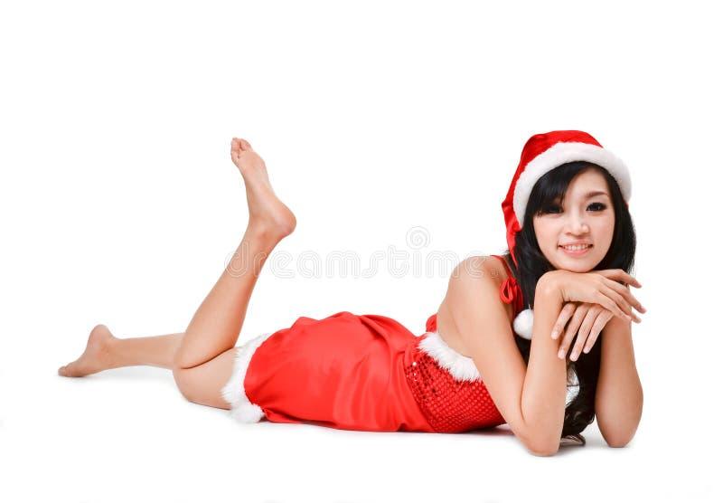 De vrouw van de kerstman die op witte achtergrond wordt geïsoleerdo stock foto