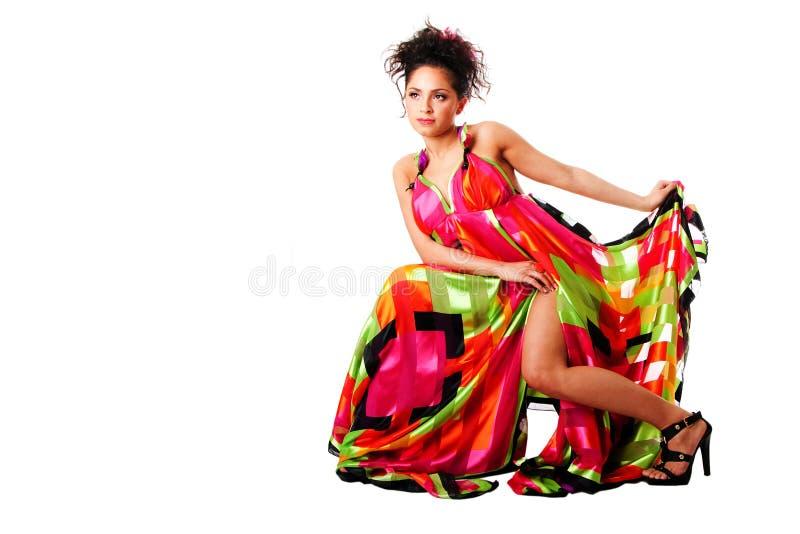 De vrouw van de manier in kleurrijke kleding stock foto