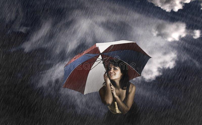 De Vrouw van de paraplu royalty-vrije stock foto's