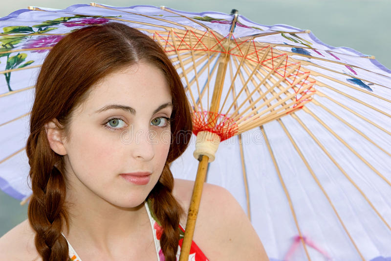 De vrouw van de parasol royalty-vrije stock foto's
