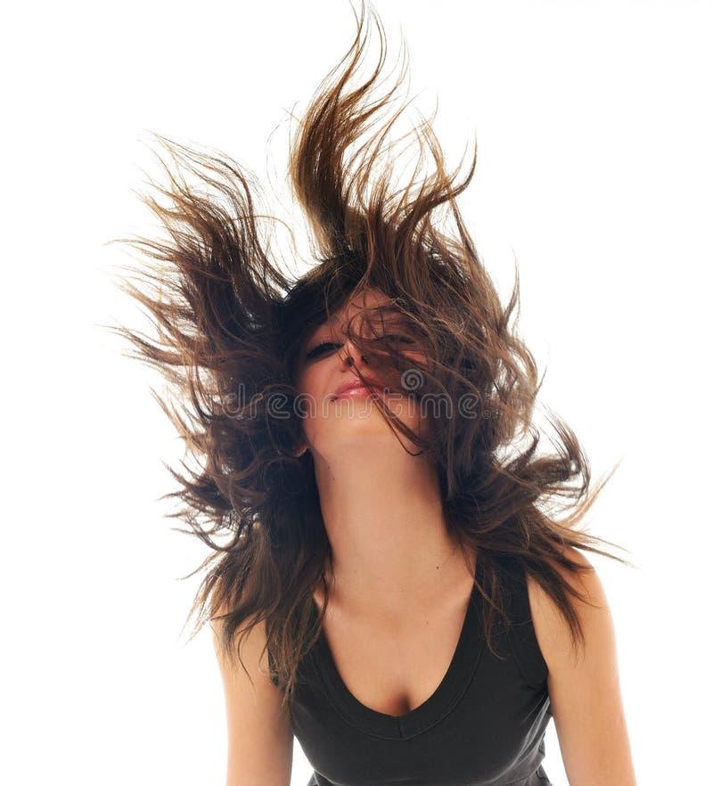 De vrouw van de partij die met wind in haar wordt geïsoleerdn stock fotografie