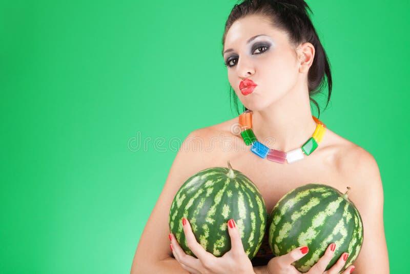 De vrouw van de pret met watermeloenen stock foto's