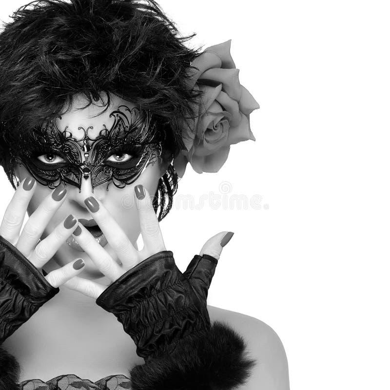De Vrouw van de schoonheidsmanier met Elegant Masker Carnaval-concept stock foto