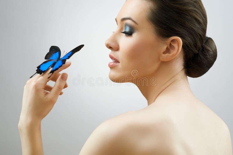 De vrouw van de vlinder stock foto's