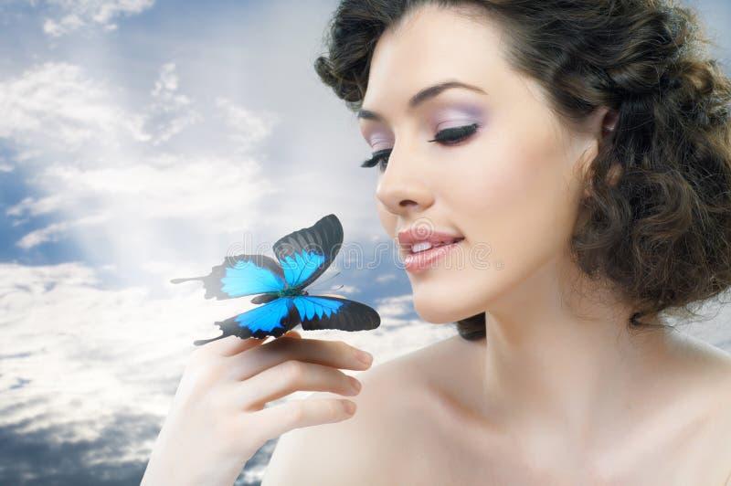 De vrouw van de vlinder stock foto
