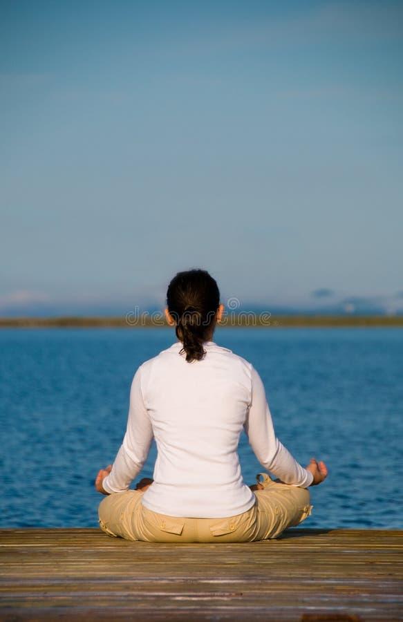 De Vrouw van de yoga royalty-vrije stock foto's