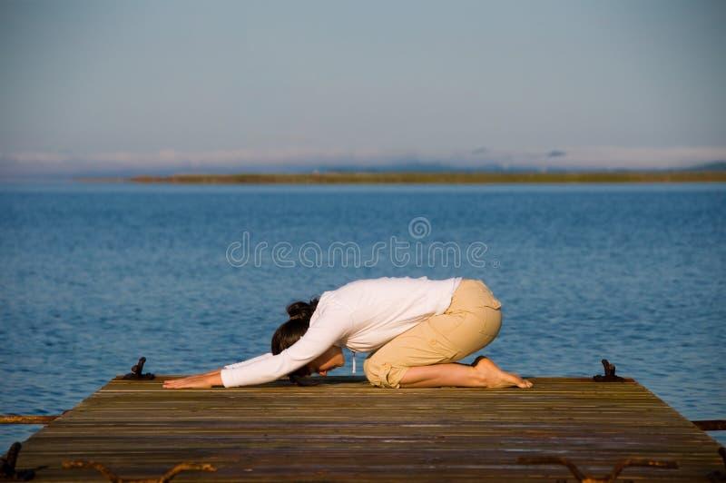 De Vrouw van de yoga royalty-vrije stock afbeeldingen