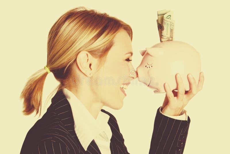 De Vrouw van het spaarvarken royalty-vrije stock afbeelding