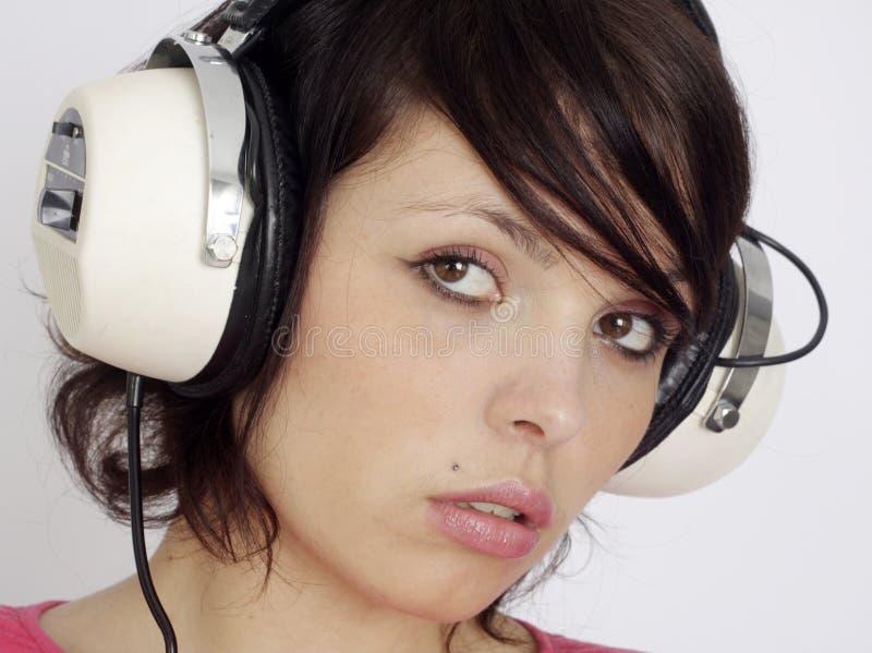De vrouw van hoofdtelefoons stock fotografie