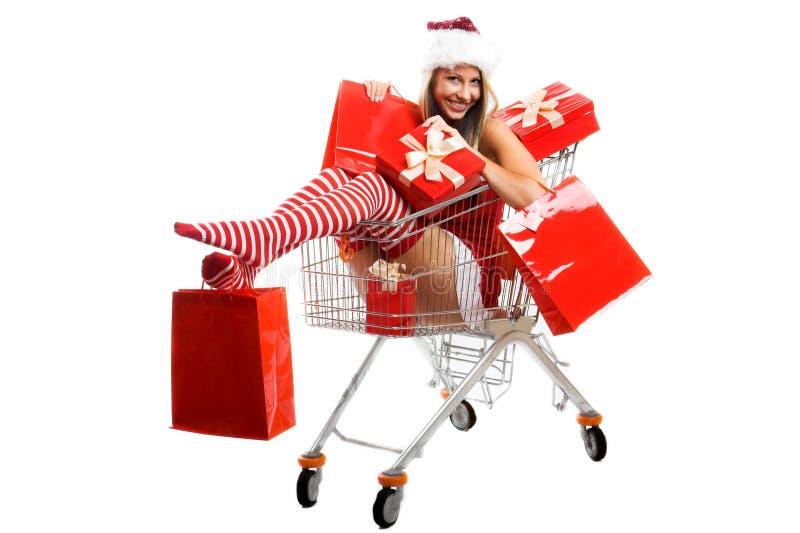 De vrouw van Kerstmis bij het winkelen stock foto's