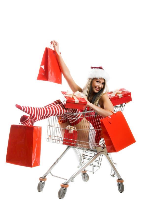 De vrouw van Kerstmis bij het winkelen stock fotografie