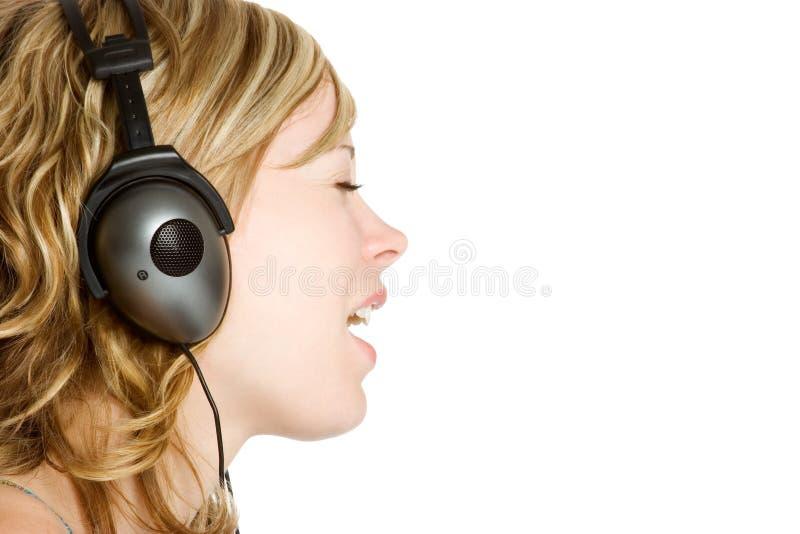 De Vrouw van oortelefoons stock foto's