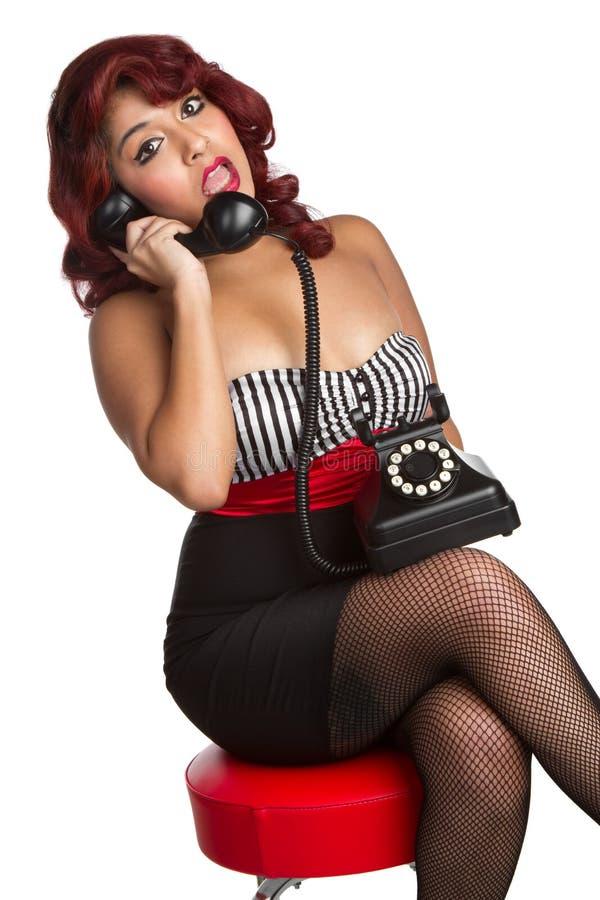 De Vrouw van Pinup op Telefoon royalty-vrije stock fotografie